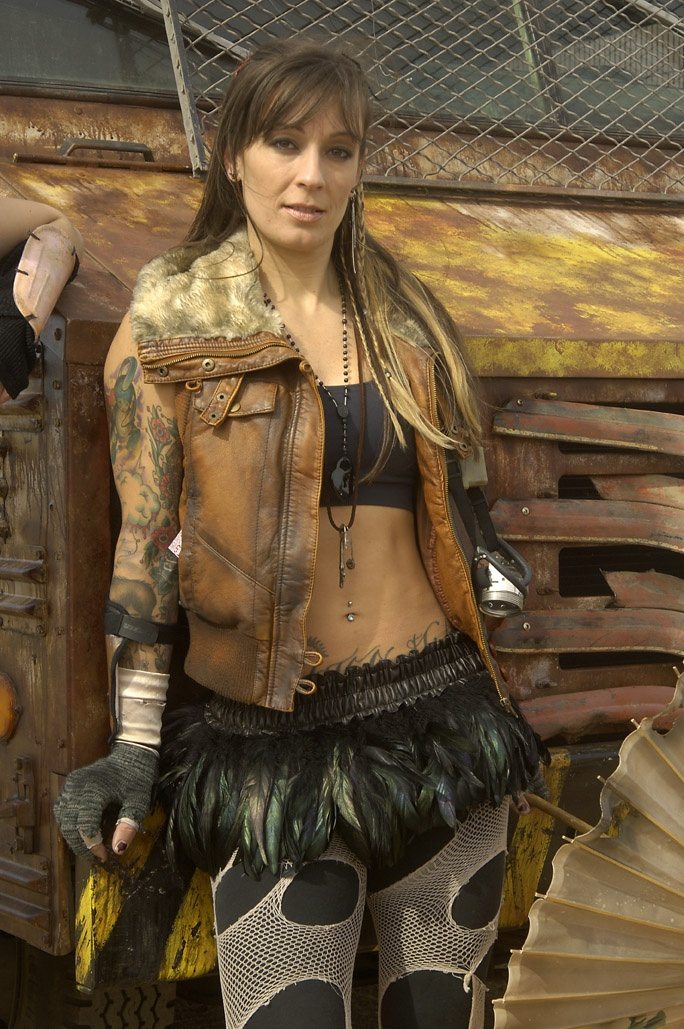 leather vest and feather skirt mad max